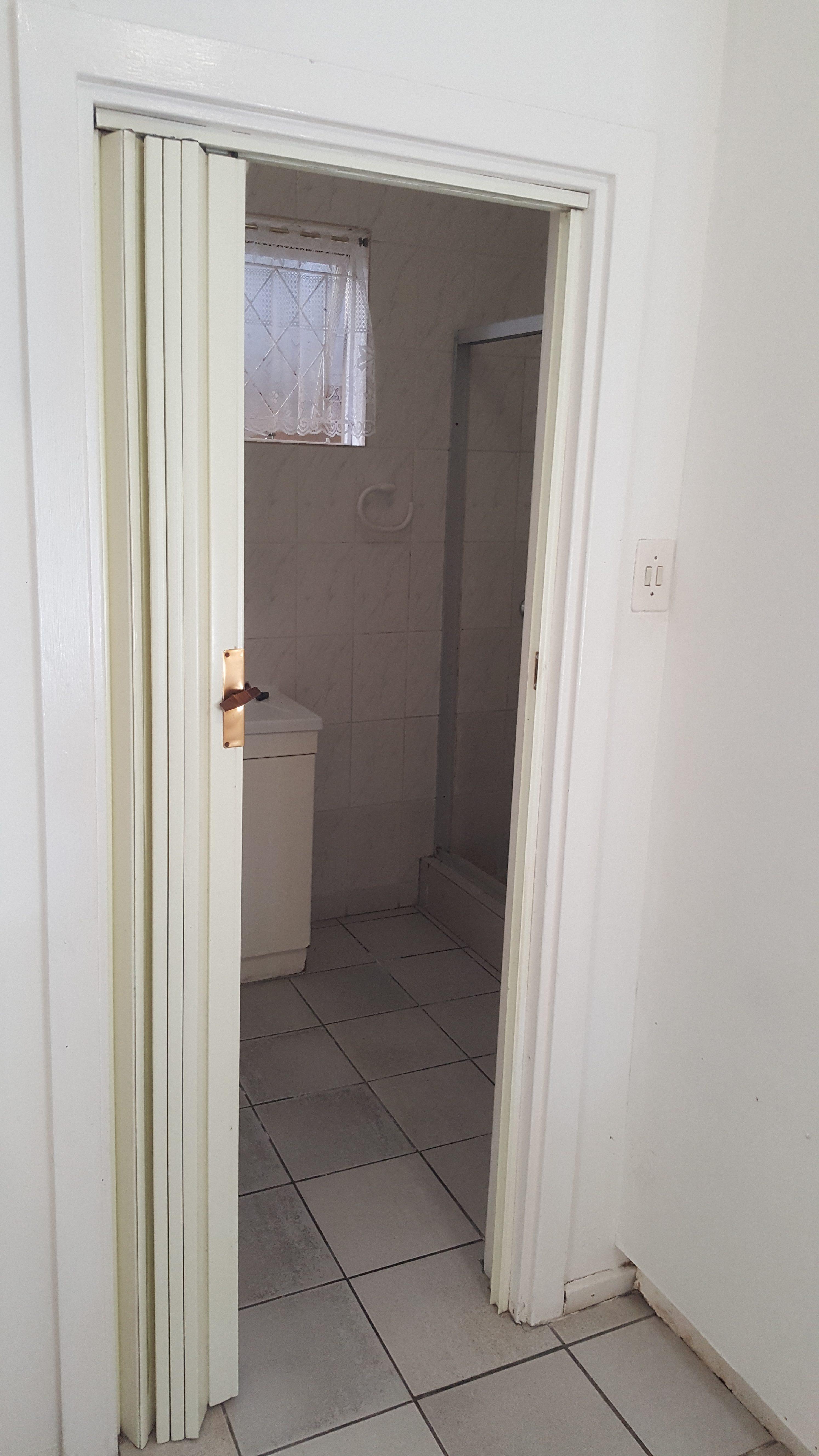 En suite bathroom with a shower, in the main bedroom.