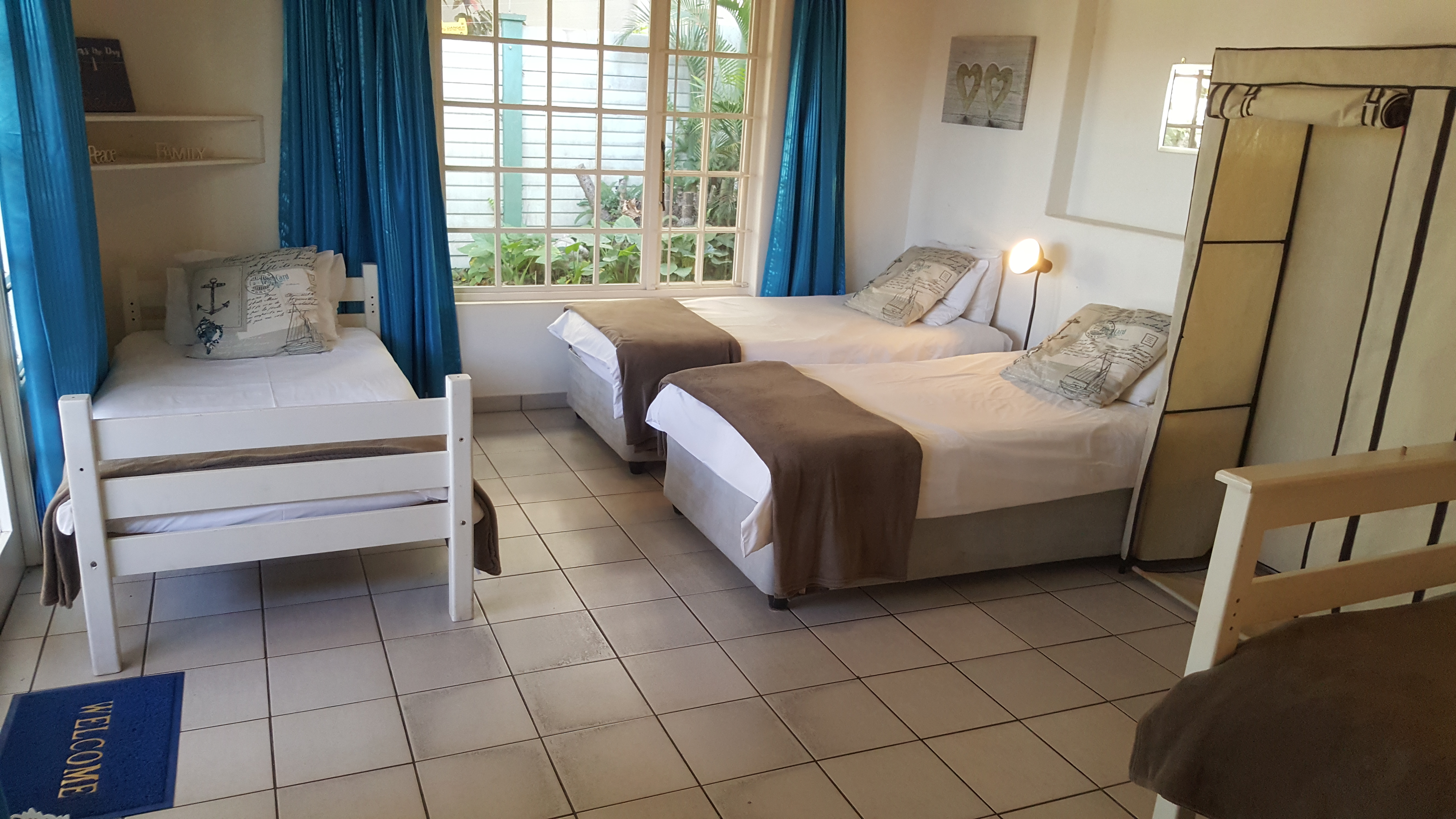 Second bedroom with 3 single beds